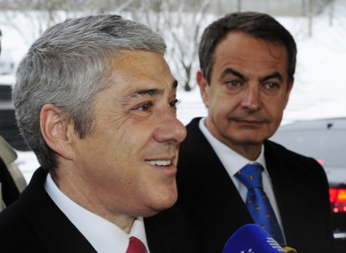 Portuguese Prime Minister Jose Socrates, left, and Spanish Prime Minister Jose Luis Rodriguez Zapatero have had other things on their mind as they attended the World Cup presentation event in Zurich.