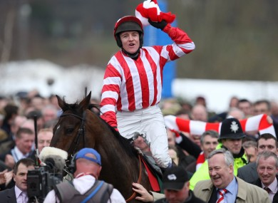 Victorious jockey Barry Geraghty celebrates on board Forpadydeplasterer after the 2009 Arkle Chase at Cheltenham