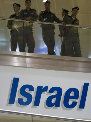 Israeli border police officers stand guard at the arrival terminal in Ben Gurion international airport near Tel Aviv