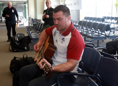 Damien Varley bangs out the tunes as the Irish team depart for Dunedin.