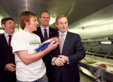 Marine Scientist Macdara O Cuaig shows Enda Kenny a fish on board the Celtic Explorer at the Dublin Docklands.