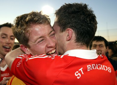 Shane Supple and Paddy Andrews celebrate St Brigid's win in the Dublin SFC final.