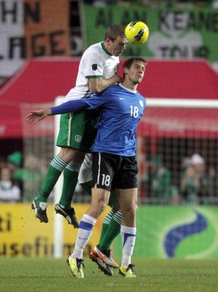 Ireland's Richard Dunne with Jarmo Ahjupera of Estonia.