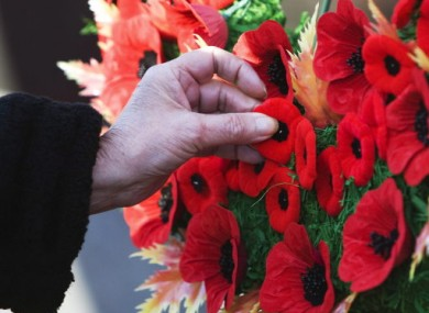 Touching the past: a woman meditates on Remembrance Day in Canada last year.