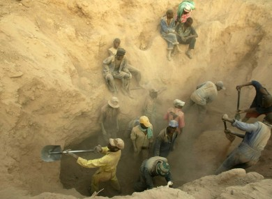 Miners dig for diamonds in Marange, Zimbabwe, Wednesday, Nov. 1, 2006