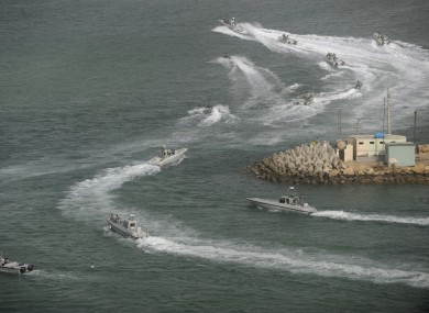 Iranian navy boats attend a drill in the sea of Oman on Friday.