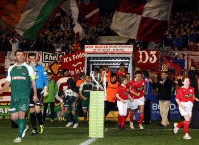 Shelbourne and Cork City come out past the First Division trophy during last season's title decider.