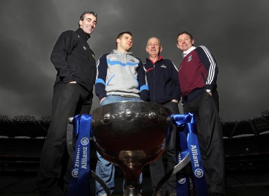 Donegal manager Jim McGuinness, Dublin footballer Kevin McManamon, Cork manager Conor Counihnan and Galway manager Alan Mullholland at yesterday's Allianz National Football League launch.