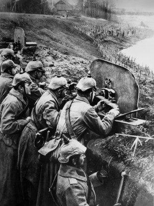 File photo circa 1918 of German soldiers at a trench-mounted machine gun.