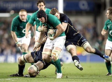Ferris is tackled by John Barclay and Richie Gray at Lansdowne Road.