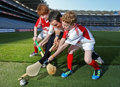 Daniel Ryan (10), left, and Matthew Ryan (9) go up against Dublin's Ryan O'Dwyer at the launch of the 2011 Kellogg's GAA Cúl Camps in Croke Park.