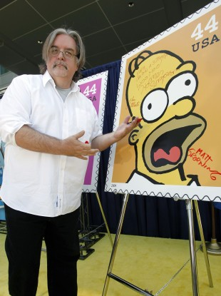 Matt Groening signs a Homer Simpson stamp in 2009.