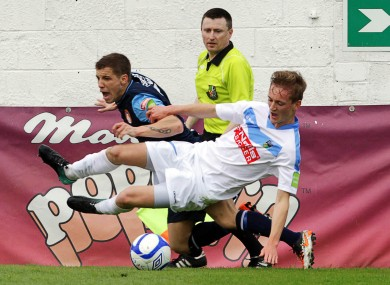 St. Pat's Darren Meenan and Barry McCabe of UCD tussle for possession