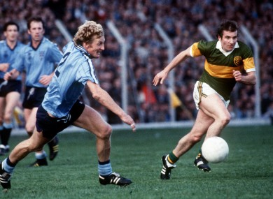 Mick Holden of Dublin and John Egan of Kerry chase a loose ball during a 1984 encounter.