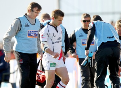 Ulster's Paul Marshall leaves the field injured.