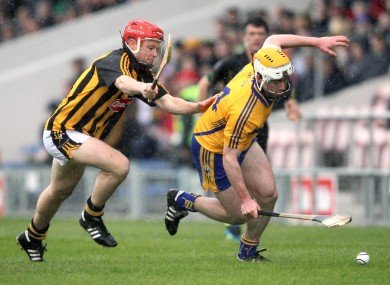 Conor McGrath is chased by Tommy Walsh