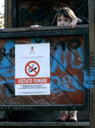 A sign in Italy reads: no smoking in the presence of infants and children including 12-year-olds, and of pregnant women.