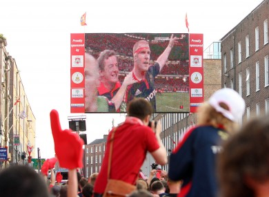 Munster fans celebrate in O'Connell st, Limerick, watching a victorious Paul O'Connell in 2008.
