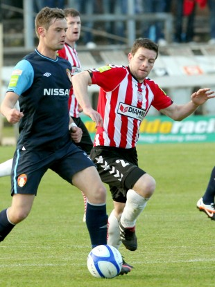 Pat's midfielder Greg Bolger is closed down by Eddie McLaughlin.