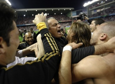Real Madrid coach Jose Mourinho celebrates with his players after winning the title.