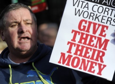 A protester shows support for the Vita Cortex workers at a public rally at Leinster House in January