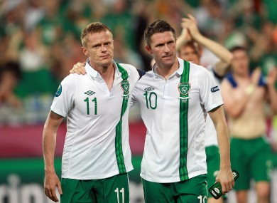 Brothers in arms: Damien Duff and Robbie Keane trudge off at the end of the game.