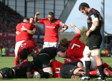 Simon Zebo celebrates Peter O'Mahony's try.