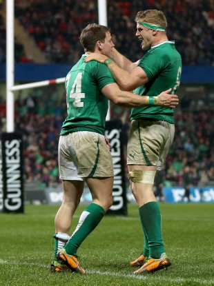 Craig Gilroy celebrates his second try with Jamie Heaslip.