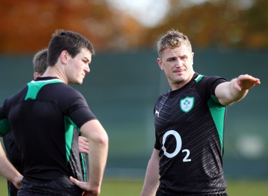 JJamie Heaslip (right) gives directions to Jonny Sexton.