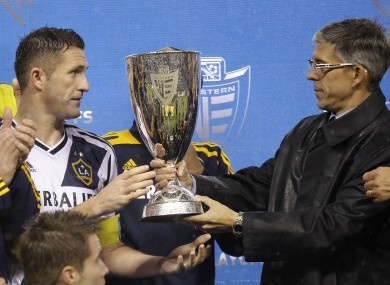 Los Angeles Galaxy captain Robbie Keane, left, is given the MLS Western Conference championship cup.