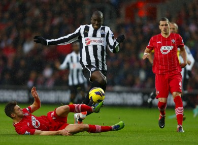 Newcastle's Demba Ba (centre) in action against Southampton's Adam Lallana during the Barclays Premier League match at St Mary's.