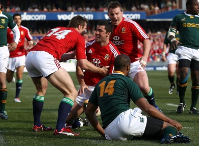 Rob Kearney is congratulated by Tommy Bowe after a try against South Africa in 2009.