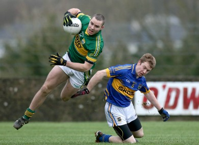 Kerry's Patrick Curtain beats Brian Fox to the ball.