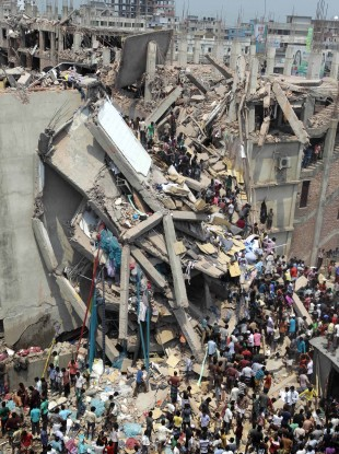 People and rescuers gather after an eight-story building housing several garment factories collapsed in Savar, near Dhaka, Bangladesh, today.