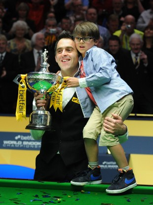 Ronnie O'Sullivan celebrates his trophy win with son Ronnie Jr.