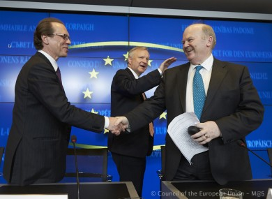 Michael Noonan is congratulated by European Commissioners Algirdas Semeta and Olli Rehn at the conclusion of last week's marathon meeting.