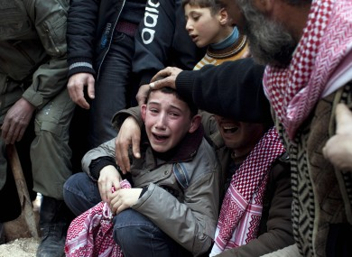 A Syrian boy mourns his father who was killed by a Syrian Army sniper in Idlib, north Syria last year.