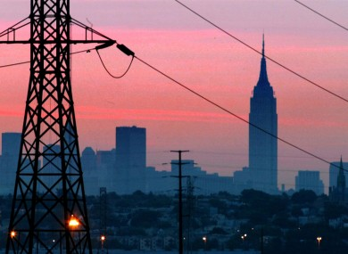 The Empire State Building towers over the skyline of a blackout-darkened New York City