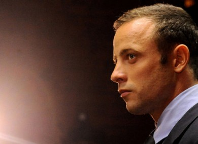Olympic athlete Oscar Pistorius stands in the dock during his bail hearing at the magistrates court in Pretoria. (File photo)