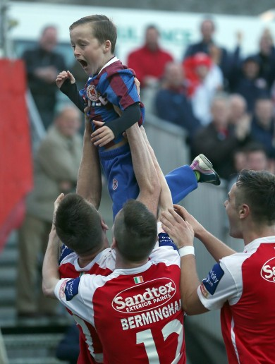 Snapshot: St Pat's players celebrate title-clinching goal with young supporter