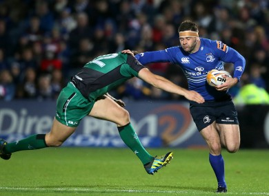Fergus McFadden of Leinster fends off Connacht's Craig Ronaldson.