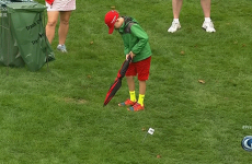Young Tiger Woods fan takes the perfect imaginary putt