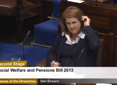 Joan Burton listening to opposition TDs in the Dáil today