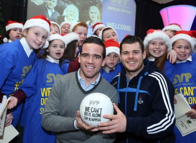 Ger Brennan and Kevin McManamon surrounded by Margaret's National School Choir at the official launch of SVP Annual Appeal.