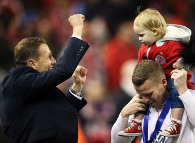 Baraclough celebrates with Danny North and his daughter Mia Grace after the game.