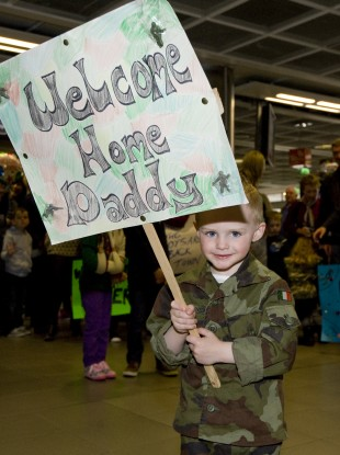 2-year-old Ben Naughton, from Galway, waits for his father to return home from Lebanon in May.