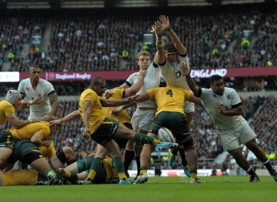 Will Genia was blocked down for England's first try.