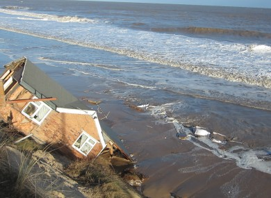 One of five bungalows in Hemsby, Norfolk which fell into the sea last night