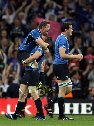 Brian O'Driscoll leaps on teammate Jamie Heaslip after defeating Northampton in 2011.