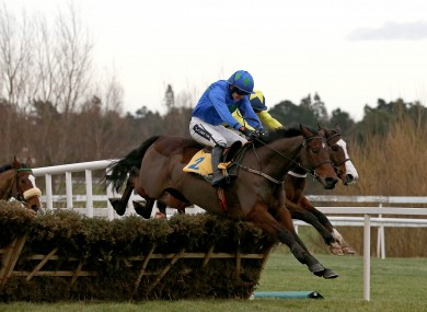 Hurricane Fly ridden by Ruby Walsh clears the last fence on his way to winning.